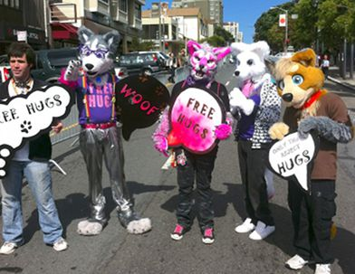 Fursuiters with 'free hugs' signs at GaymerX