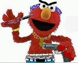 Elmo waving a gun and knife