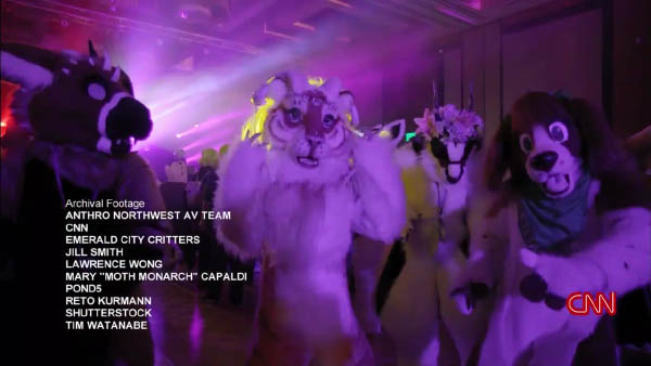 Lisa Ling in a tiger fursuit, dancing with other fursuiters.
