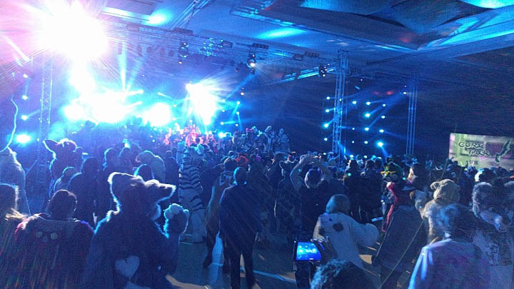 The Friday night dance at Midwest FurFest 2017. Photo by @TygerWDR on Twitter.