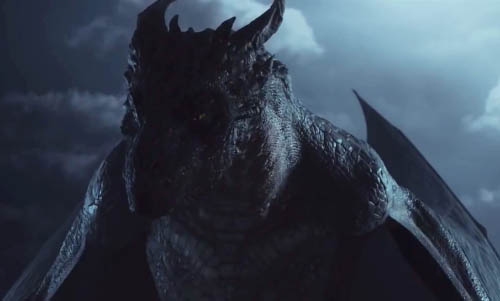 A darkly-lit shot of the dragon showing his head, shoulders and upper torso.
