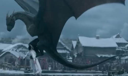 The dragon grabs Mira in his talons to carry her away.